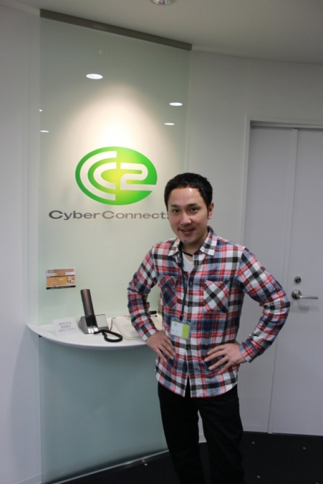 Willkommen! <br><br> Hiroshi Matsuyama ist Präsident sowie CEO von CyberConnect2 und bereitet seinen Gästen einen herzlichen Empfang. 2317617