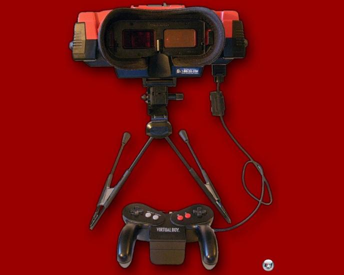 <b>Die Hardware</b> <br><br> Auf den ersten Blick erinnert der Virtual Boy an die riesigen Roboter-Tripods aus der Endzeit-Serie »Die dreibeinigen Herrscher«. In seinem Inneren tickt mit dem NEC V810 bereits ein 32-Bit-RISC-Prozessor, der auch in NECs japanischem Konsolen-Heimcomputer-Mischling »PC-FX« verbaut wurde. Die Technik funktioniert ähnlich wie bei anderen 3D-Systemen. Beide Augen sehen eine leicht nach rechts bzw. links versetzte Version der Szene, das Gehirn formt daraus ein dreidimensionales Bild. Anders als beim 3DS kann die Ausrichtung der Bildschirme übrigens mit zwei Reglern individuell auf die Augen ausgerichtet werden. 2211689