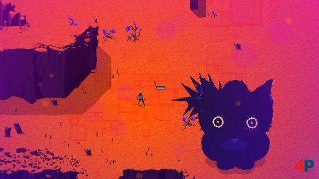 Komm, kleine Mieze: Mitten in der lebensfeindlichen Pixelwüste taucht plötzlich eine Riesenkatze aus dem Sand auf.